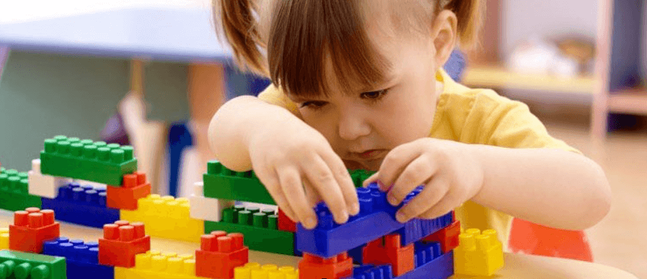 Pre school student playing with toys